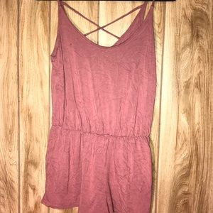Pink romper with cross in back